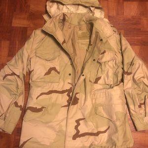 US military cold-weather M 65 desert camo coat.
